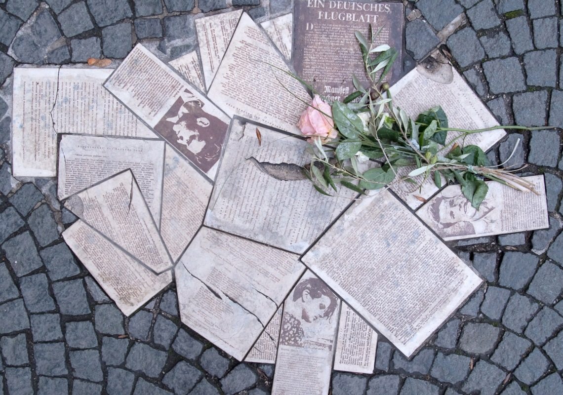 """In front of the entrance to the main building of the Ludwig-Maximilians-Universität (LMU) at Geschwister-Scholl-Platz the leaflets of the resistance group """"White Rose"""" are embedded in the ground as a monument in 2018. (Photo by Sven Hoppe/picture alliance via Getty Images)"""