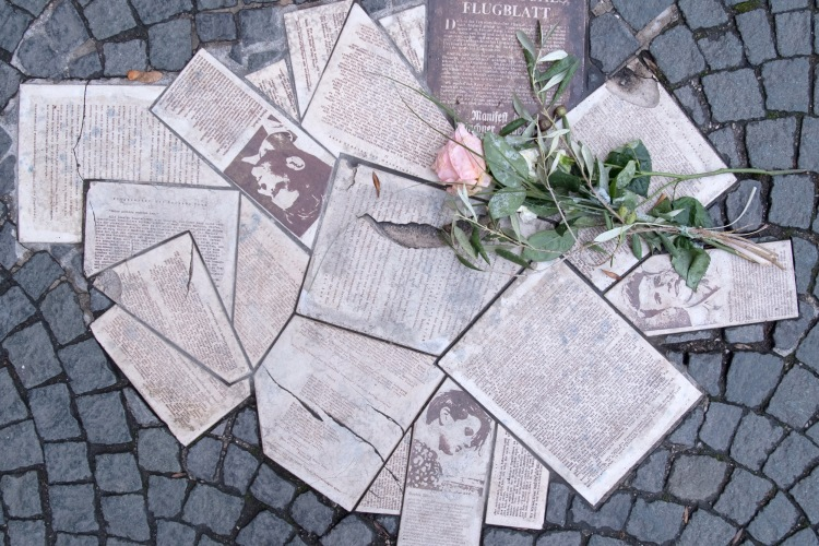 "In front of the entrance to the main building of the Ludwig-Maximilians-Universität (LMU) at Geschwister-Scholl-Platz the leaflets of the resistance group ""White Rose"" are embedded in the ground as a monument in 2018. (Photo by Sven Hoppe/picture alliance via Getty Images)"