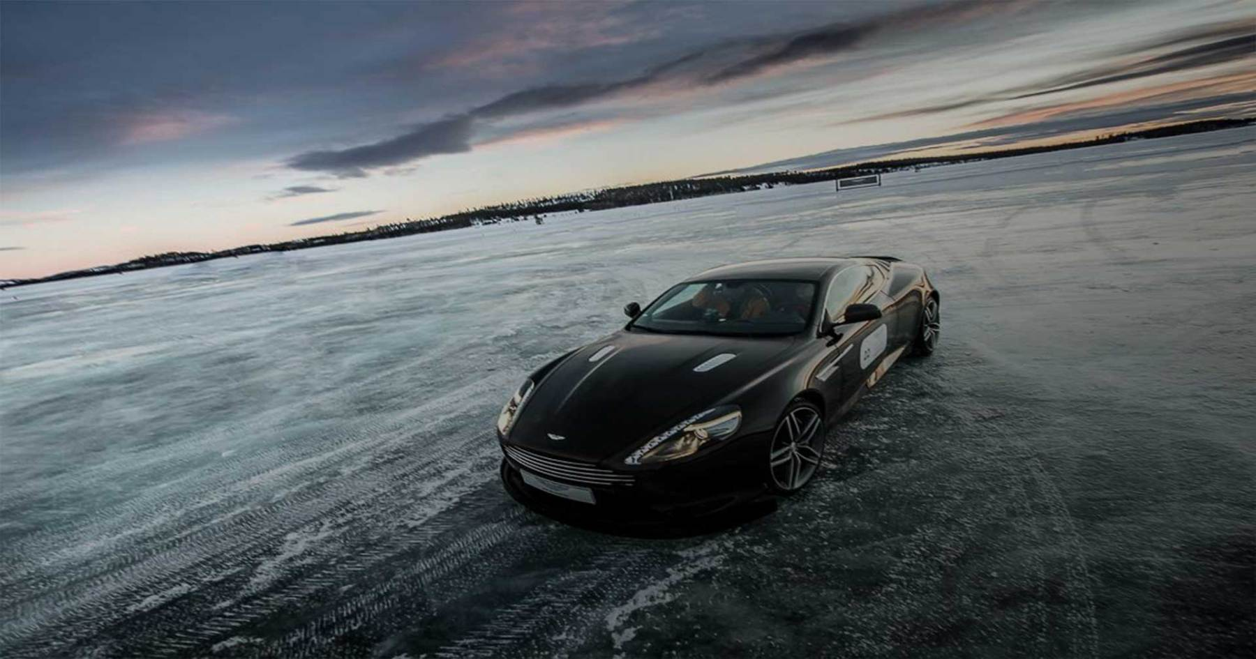 100 MPH in an Aston Martin. On Ice.