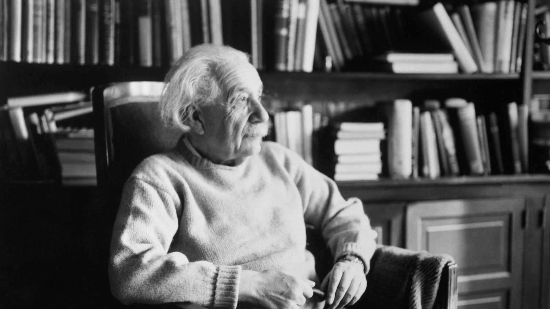 Princeton, New Jersey: Physicist Albert Einstein (1879-1955), seated in book-filled office. (Getty Images)