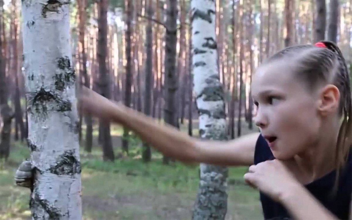 Here's a Nine-Year-Old Girl Beating the Sh*t Out of a Tree
