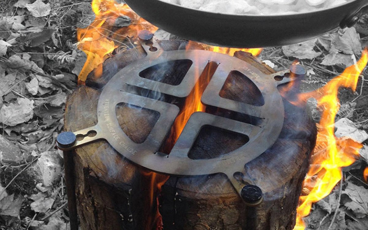 A Piece of Stainless Steel That Turns Any Log Into a Grill