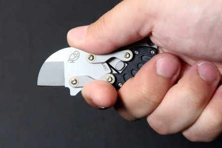 Good Luck Not Losing This Coin-Sized Folding Knife