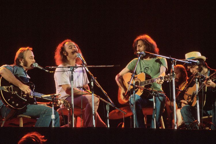 Crosby Stills Nash and Young perform in 1974 in London. (Getty Images)