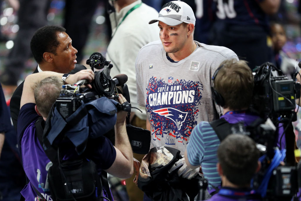 ATLANTA, GEORGIA - FEBRUARY 03:  Rob Gronkowski #87 of the New England Patriots is interviewed after his teams 13-3 win over the Los Angeles Rams during Super Bowl LIII at Mercedes-Benz Stadium on February 03, 2019 in Atlanta, Georgia. (Photo by Patrick Smith/Getty Images)