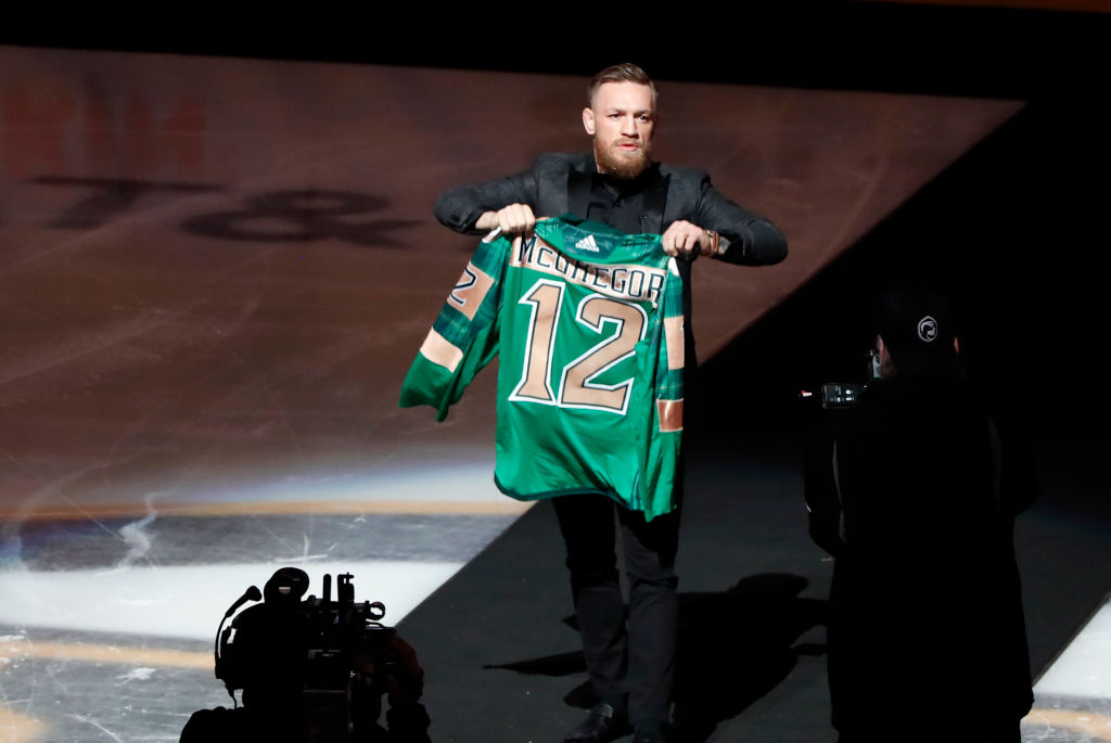 BOSTON, MA - MARCH 16: Conor McGregor walks to center ice to drop the puck on Irish Heritage Night on St. Patrick's eve before a game between the Boston Bruins and the Columbus Blue Jackets on. March 16, 2019, at TD Garden in Boston, Massachusetts. (Photo by Fred Kfoury III/Icon Sportswire via Getty Images)