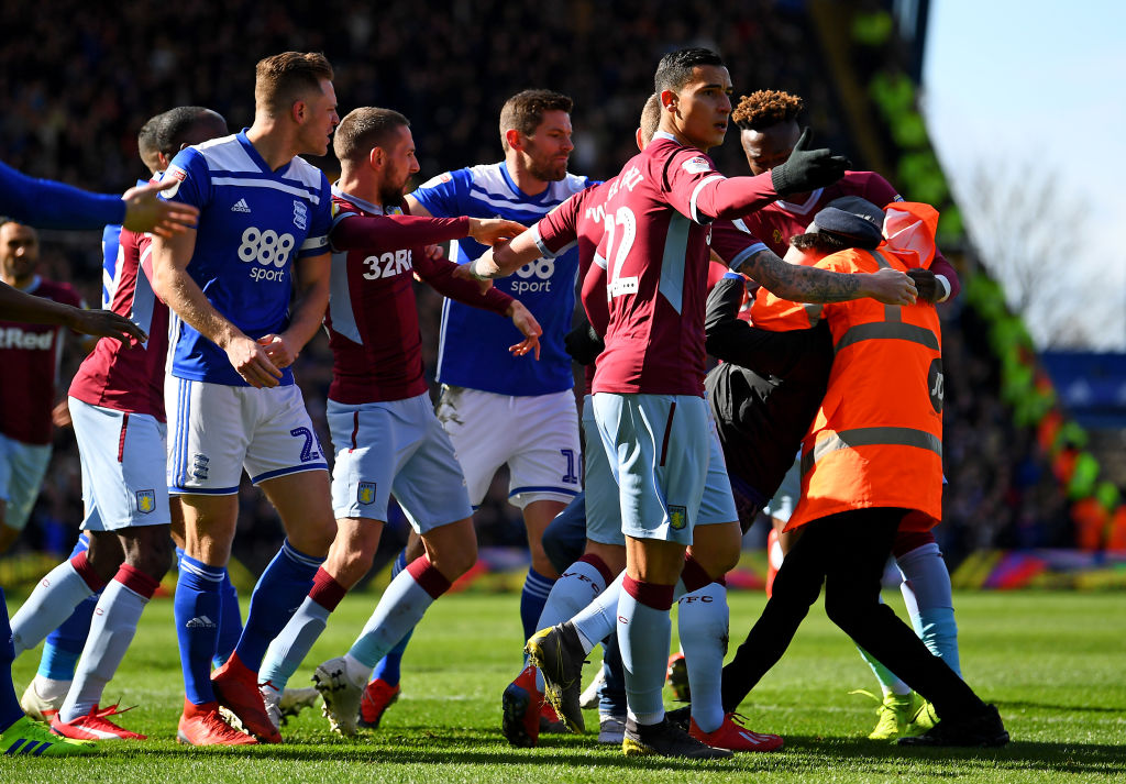 A fan is wrestled to the ground by a steward after punching Jack Grealish of Aston Villa during the Sky Bet Championship match between Birmingham City and Aston Villa at St Andrew's Trillion Trophy Stadium on March 10, 2019 in Birmingham, England. (Photo by Alex Davidson/Getty Images)