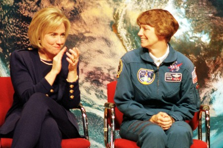First lady Hillary Rodham Clinton (L) applauds astronaut Eileen Collins during a visit with science students at Dunbar High School March 5, 1998 in Washington, DC. Collins has been named the first woman commander of a NASA mission which will launch in April of 1999. (photo by Karin Cooper)