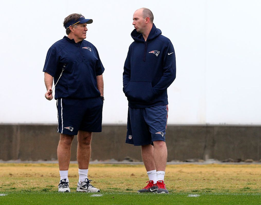 TEMPE, AZ - JANUARY 30:  Head coach Bill Belichick of the New England Patriots talks with Jack Easterby during the New England Patriots Super Bowl XLIX Practice on January 30, 2015 at the Arizona Cardinals Practice Facility in Tempe, Arizona.  (Photo by Elsa/Getty Images)