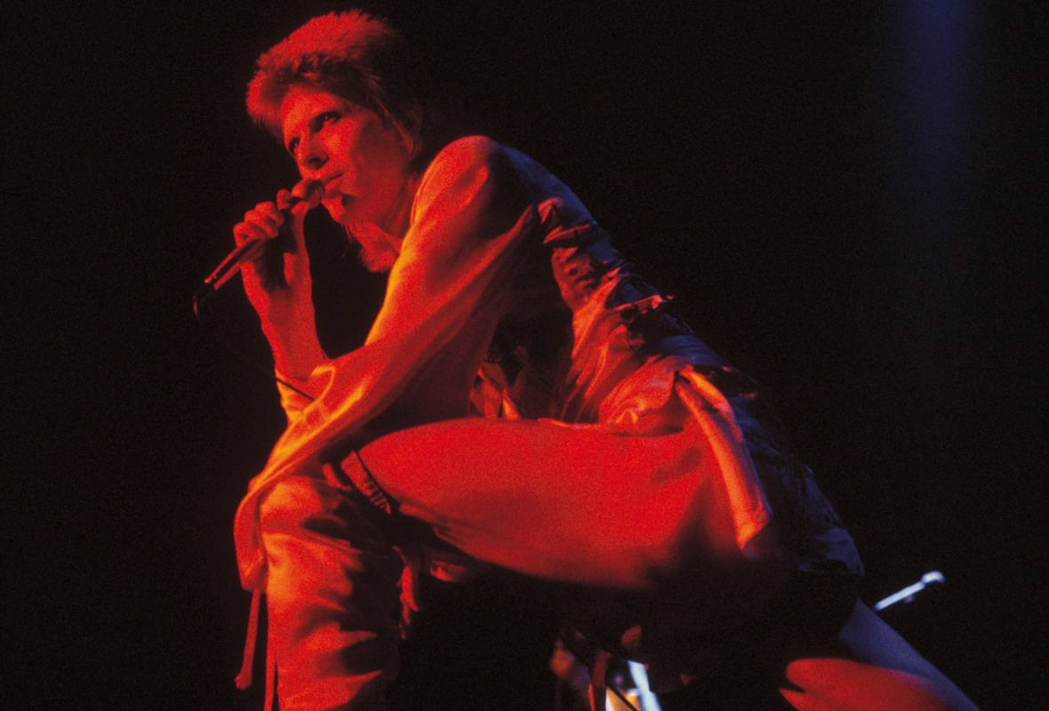 David Bowie performing as Ziggy Stardust at the Hammersmith Odeon, 1973. (Getty Images)