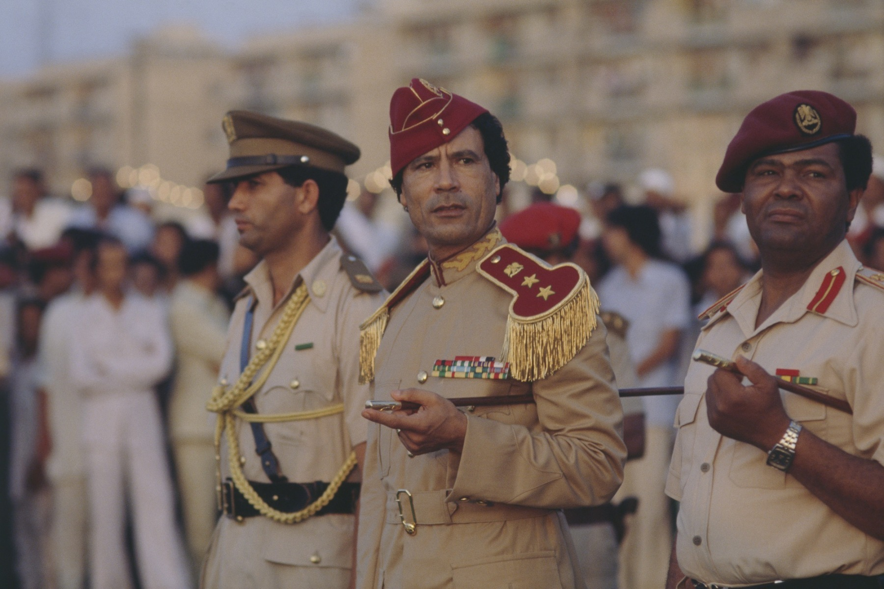 Libyan chief of state Muammar al-Qaddafi attends a 1981 graduation at the women's military academy in Tripoli. The academy opened in 1979 during Qaddafi's push to include women in Libya's armed forces. (Photo by Christine Spengler/Sygma/Sygma via Getty Images)