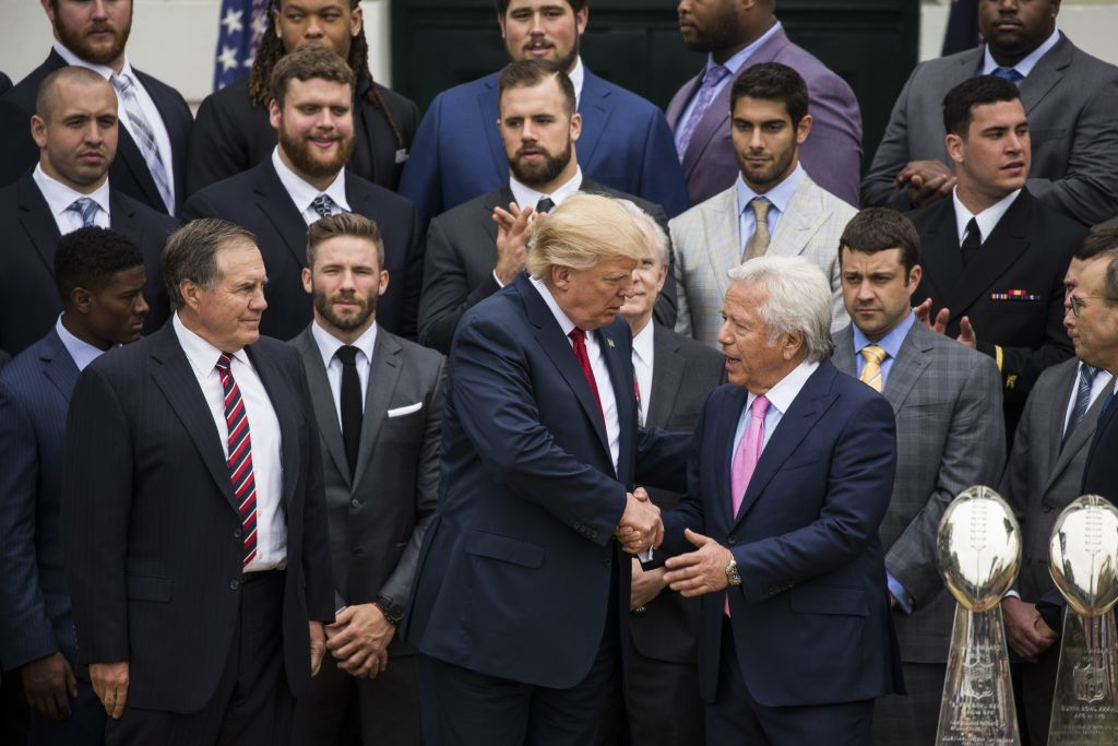 Robert Kraft (right), owner of the New England Patriots, is shown here shaking hands with President Donald Trump at the White House on April 19, 2017. (Photo by Samuel Corum/Anadolu Agency/Getty Images)