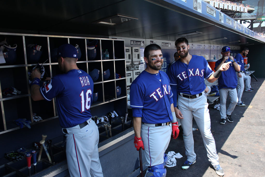 NEW YORK, NEW YORK - August 9:  Brett Nicholas #6 of the Texas Rangers and Joey Gallo #13 of the Texas Rangers in the dugout preparing to bat during the Texas Rangers Vs New York Mets regular season MLB game at Citi Field on August 9, 2017 in New York City. (Photo by Tim Clayton/Corbis via Getty Images)