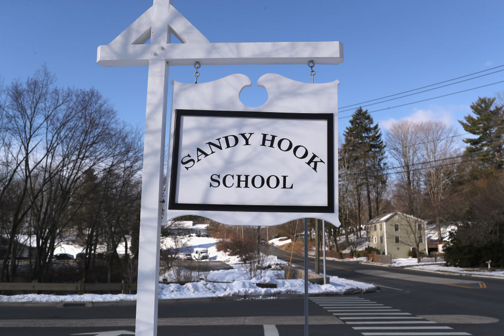 A sign stands near the site of the December 2012 Sandy Hook school shooting on the day of the National School Walkout on March 14, 2018 in Sandy Hook Connecticut. Several hundred students at the school, near the site of the Sandy Hook school massacre of December 14, 2012, staged a protest one month after 17 people were killed at Stoneman Douglas High School in Parkland, Florida. Media and visitors were not allowed on the Newtown High campus for the event.  (Getty Images)