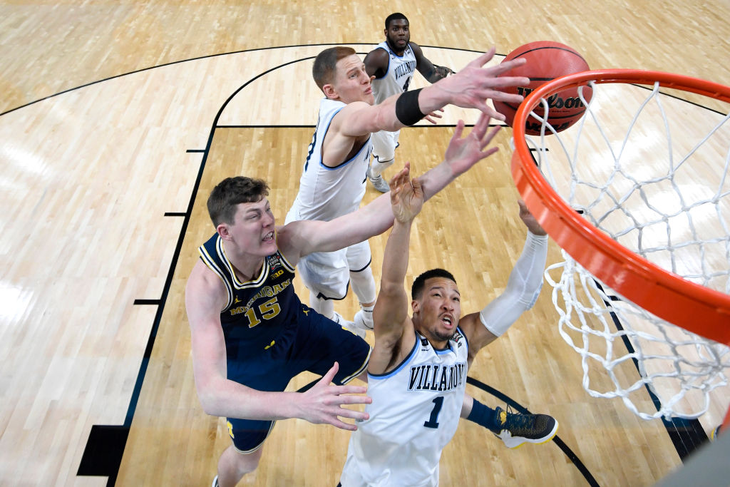 SAN ANTONIO, TX - APRIL 02: Jon Teske #15 of the Michigan Wolverines competes for the ball against Jalen Brunson #1 and Donte DiVincenzo #10 of the Villanova Wildcats during the second half of the 2018 NCAA Men's Final Four National Championship game at the Alamodome on April 2, 2018 in San Antonio, Texas.  (Photo by Brett Wilhelm/NCAA Photos via Getty Images)