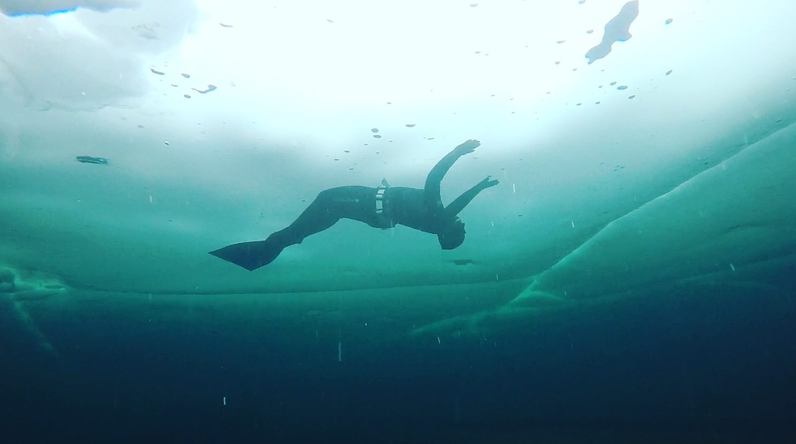 Magali Cote, free diving under the ice.