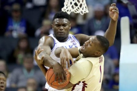 Zion Williamson blocks a shot by Raiquan Gray (Photo by Streeter Lecka/Getty Images)