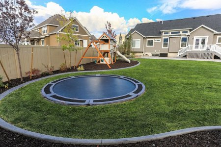 Don't Trust Your Child Not to Kill Itself? Try an In-Ground Trampoline.