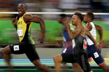 Twitter Can't Get Enough of Usain Bolt's Mid-Race Grin