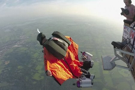 Watch a Human M80 Jump Out of a Plane With Jet Thrusters on His Feet
