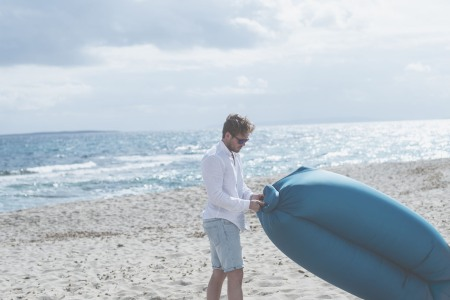 This Inflatable Lounger Is Set To Pump Up Your Summer