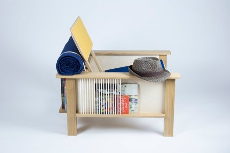 The Ultimate Reading Chair Has Its Own Bookshelf, Magazine Rack