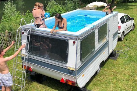 A French Artist Just Made a Swimming Pool Out of an Old Camper