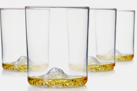 These Whiskey Tumblers Have Famous Mountains Hiding in Their Bases