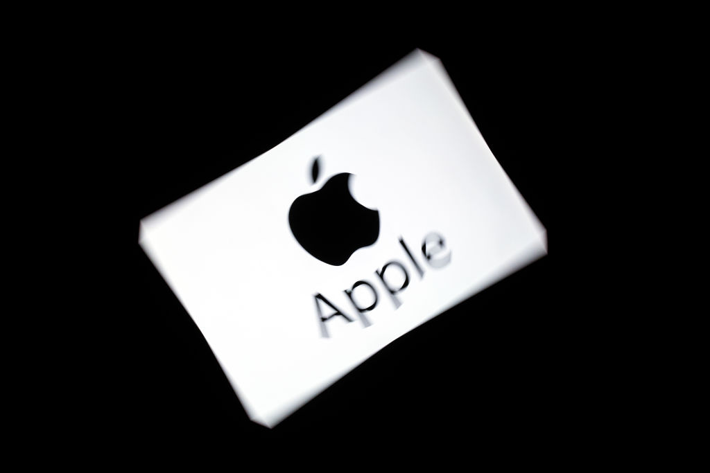 The Apple logo displayed on a tablet. (LIONEL BONAVENTURE/AFP/Getty Images)