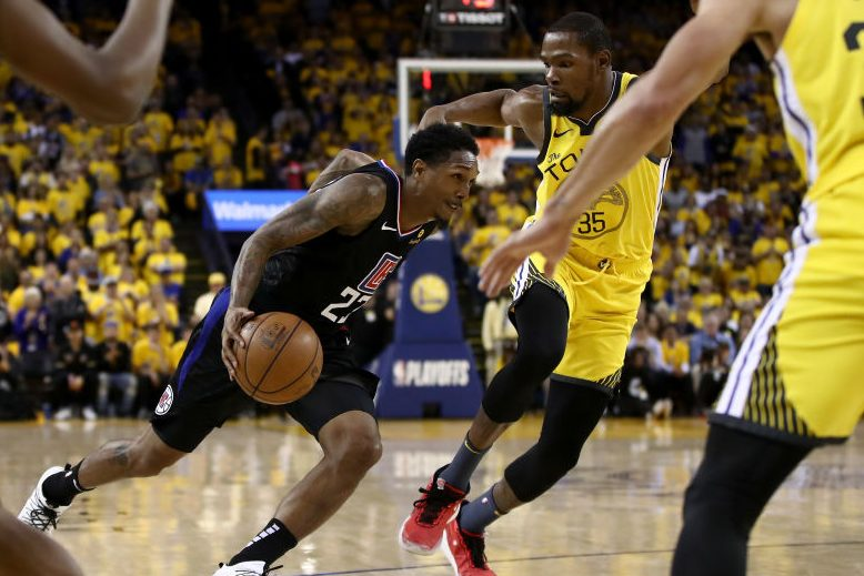 Lou Williams of the Clippers drives on Kevin Durant of the Warriors. (Photo by Ezra Shaw/Getty Images)
