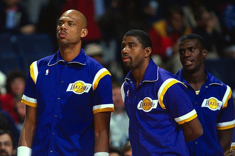 Magic Johnson with Kareem Abdul-Jabbar and Orlando Woolridge. (Photo by Focus on Sport/Getty Images)