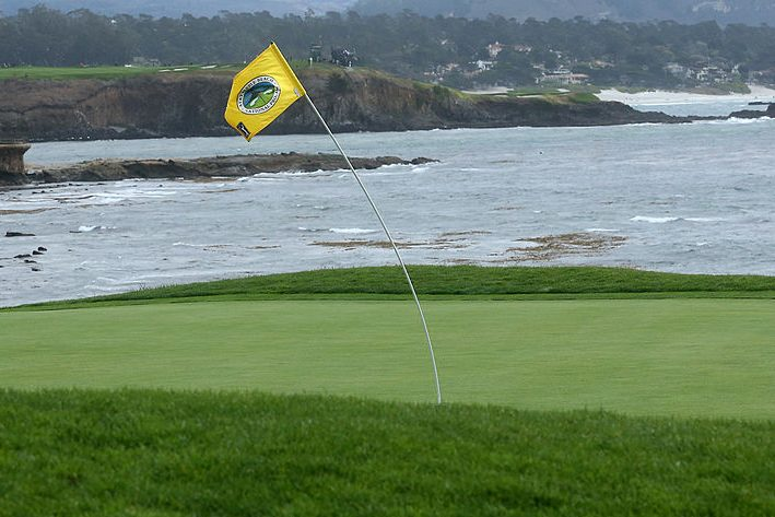 The flagstick on the 18th hole at Pebble Beach. (Photo by Stephen Dunn/Getty Images)