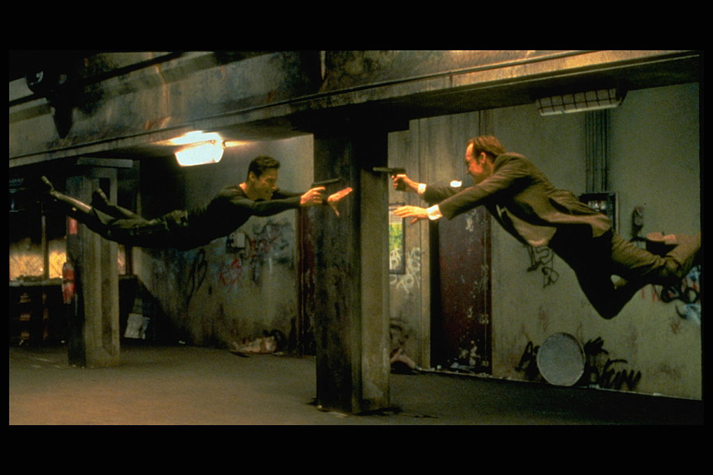 "Keanu Reeves and Hugo Weaving in scene from ""The Matrix."""