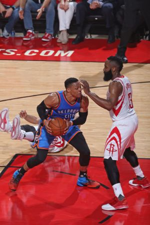 Westbrook guarded by James Harden. (Layne Murdoch/NBAE via Getty)
