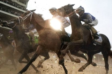 The field heads toward the first turn during the 144th running of the Kentucky Derby. (Photo by Rob Carr/Getty Images)