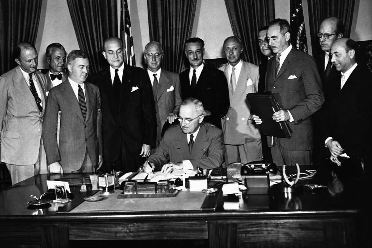 President Harry S. Truman signs the North Atlantic Pact (CORBIS/Corbis via Getty Images)