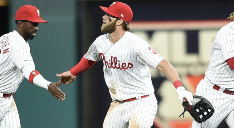 PHILADELPHIA, PA - MARCH 31: Philadelphia Phillies Outfielders Bryce Harper, Andrew McCutchen and Odubel Herrera. (Photo by Andy Lewis/Icon Sportswire via Getty Images)