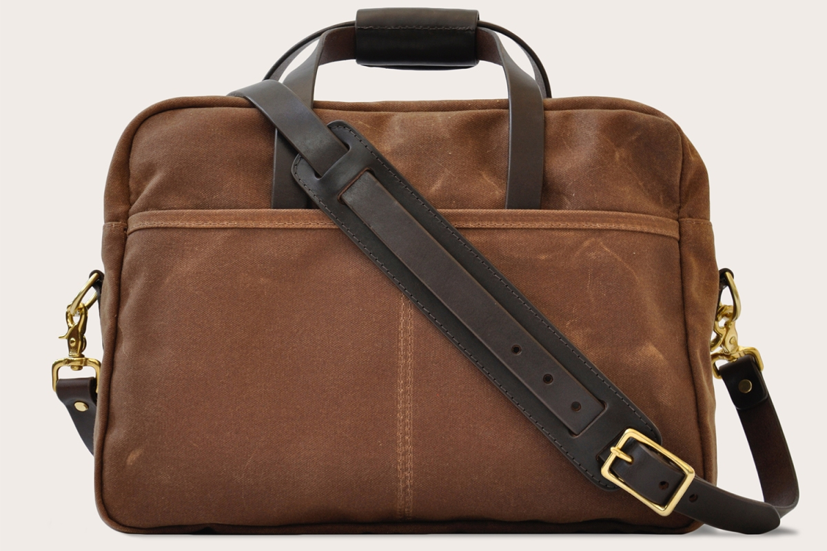 Oak Street's line of waxed canvas utility bags are back in stock.