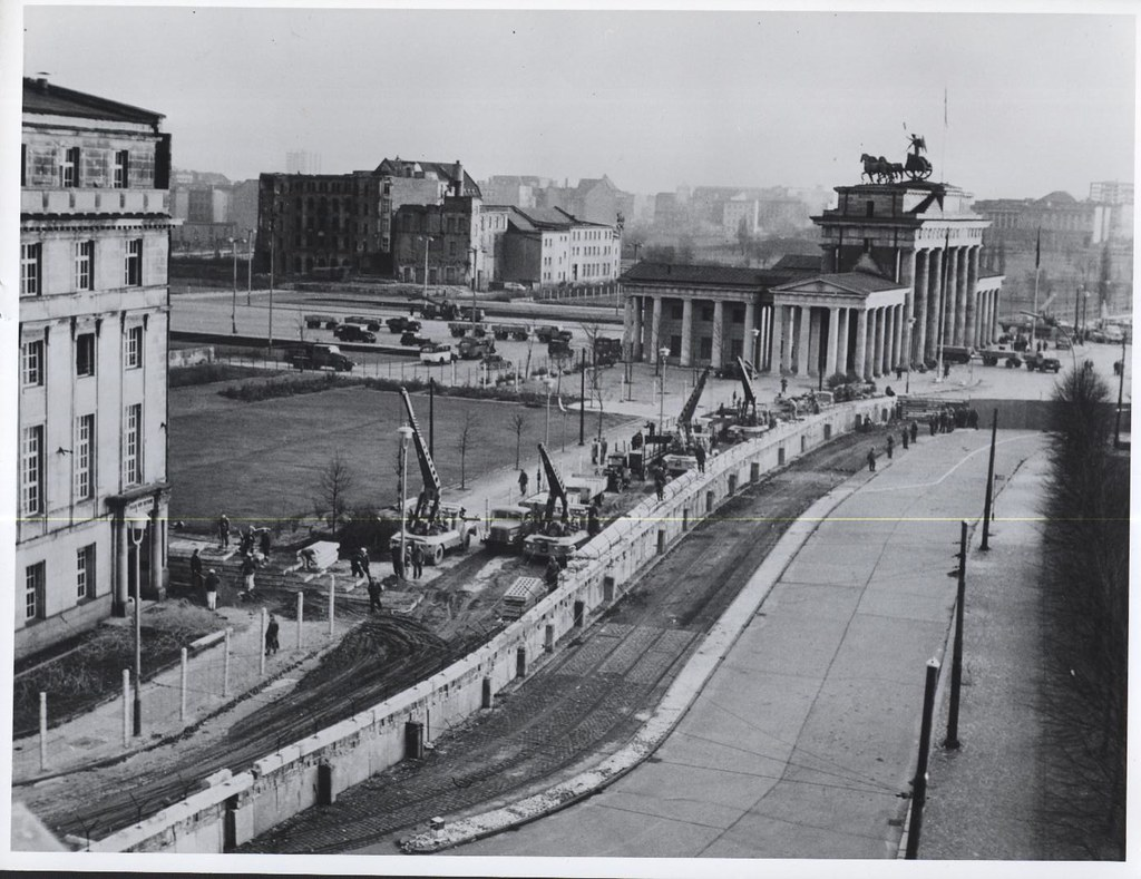 November 1961. East Germans fortify the border at the Brandenburg Gate, Berlin, expanding the concrete wall and adding a barbed-wire fence. (Photo credit: CIA archives)