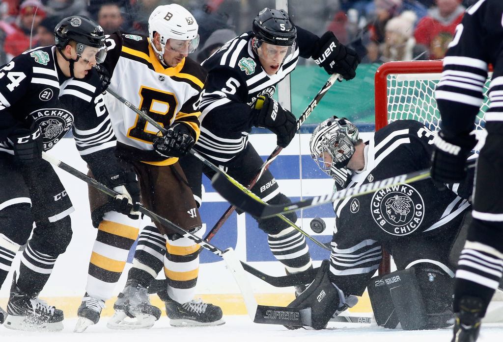 The Boston Bruins and Chicago Blackhawks in their Winter Classic sweaters. (Mark Blinch/NHLI via Getty)