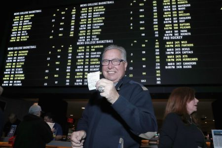Ron Jaworski places the first bet at the William Hill Sports Book in Atlantic City. (Bennett Raglin/Getty)