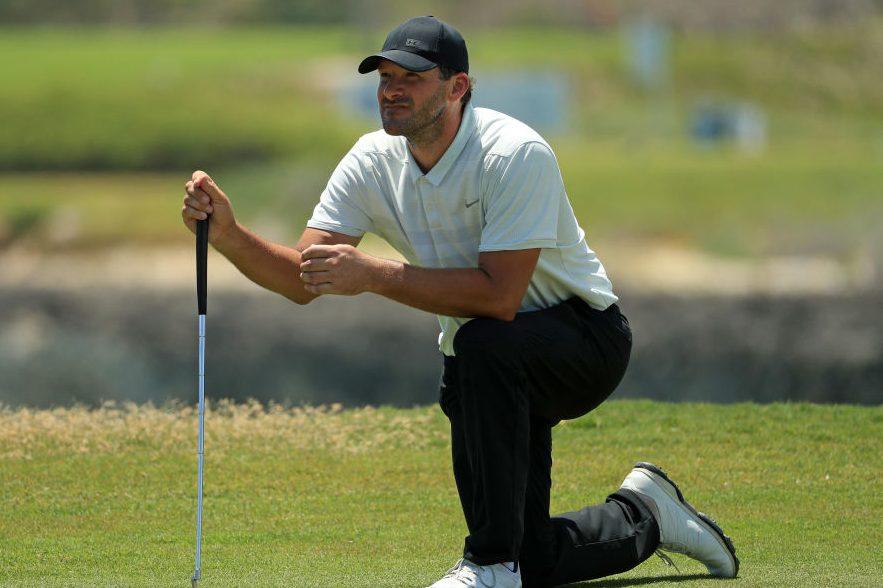 Tony Romo playing golf in 2019. (Mike Ehrmann/Getty)