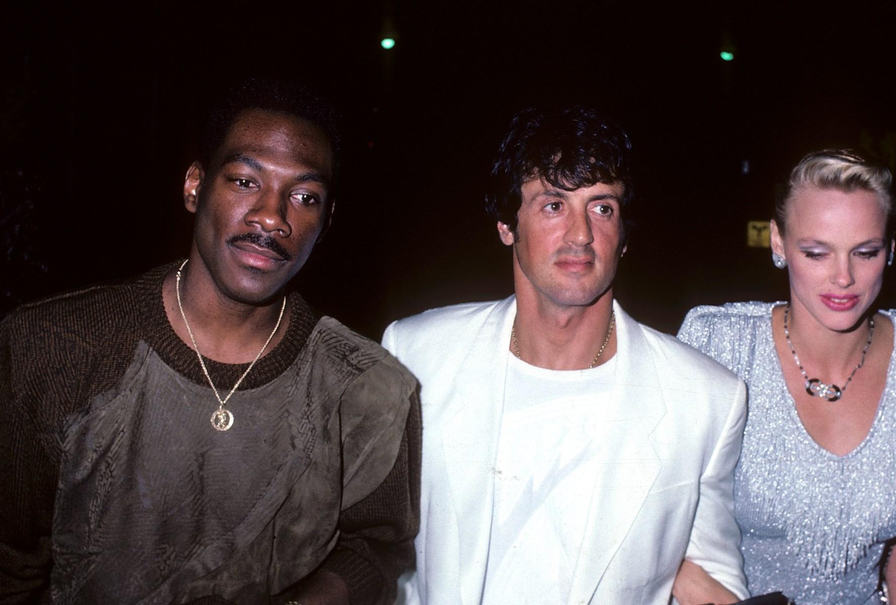 Eddie Murphy, Sylvester Stallone and Brigitte Nielsen in 1986