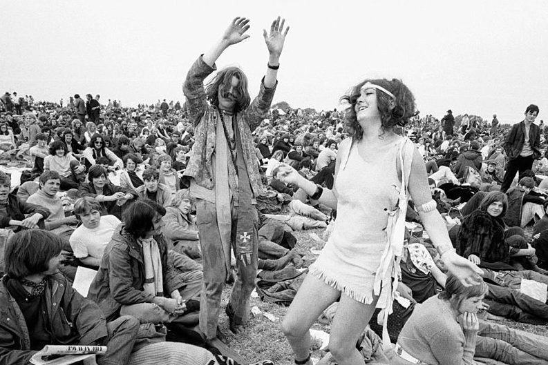 Hippies dancing at The Isle of Wight Festival in 1969. (Daily Mirror/Mirrorpix via Getty)