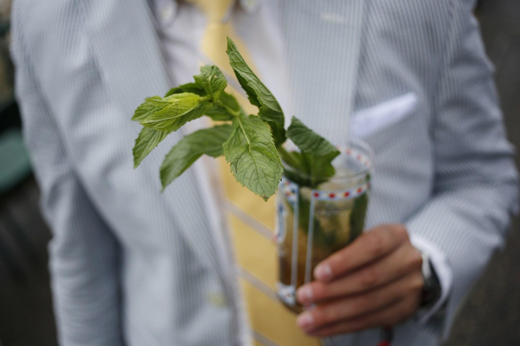 A racegoer holds a mint julep via Getty Images