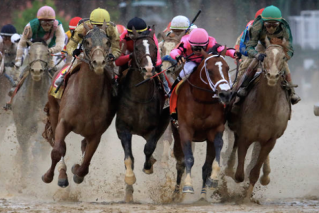 Country House (left), ridden by jockey Flavien Prat, War of Will (second from left), ridden by jockey Tyler Gaffalione, Maximum Security (second from right), ridden by jockey Luis Saez and Code of Honor, ridden by jockey John Velazquez. fight for position in the final turn during the 145th running of the Kentucky Derby at Churchill Downs on May 04, 2019 in Louisville, Kentucky. Country House was declared the winner after a stewards review disqualified Maximum Security. (Photo by Andy Lyons/Getty Images)