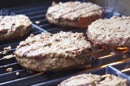 Burgers on a grill. (Tesa Robbins from Pixabay)