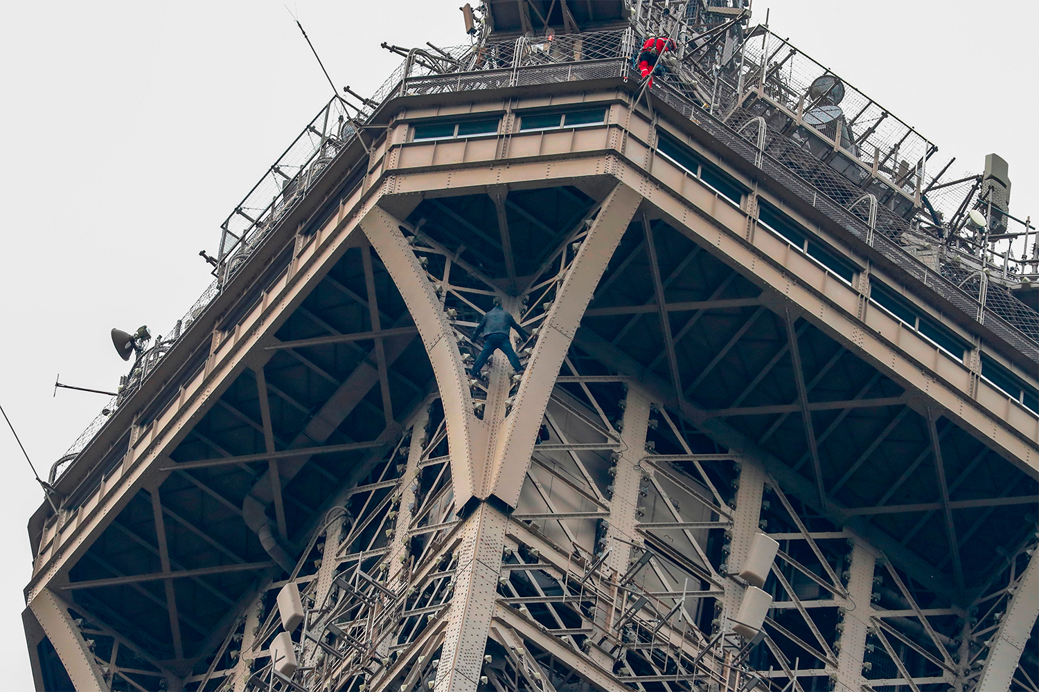 Climber Scales Side of Eiffel Tower