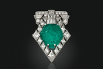 A Tiffany Art Deco carved emerald and diamond brooch