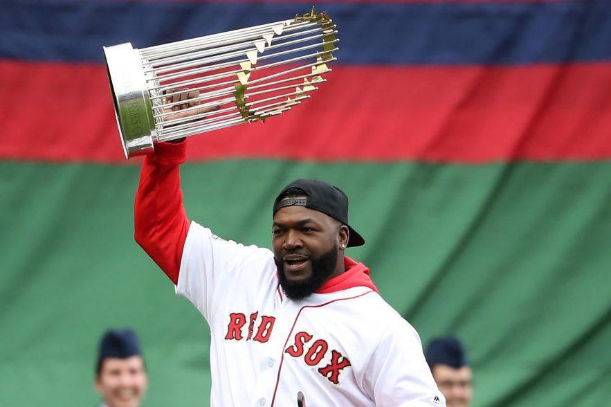 Ex-Red Sox player David Ortiz carries a World Series trophy. (Nancy Lane/MediaNews Group/Boston Herald via Getty)